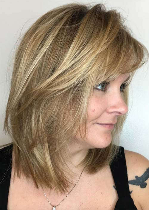 Haircuts & Hairstyles for Women Over 50: Medium Fringed Lowlights