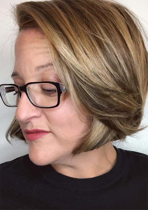 Haircuts & Hairstyles for Women Over 50: Side-Swept Highlighted Short Hair